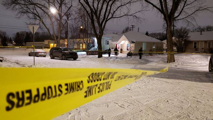 House taped off in north Edmonton community, police officers seen canvassing neighbourhood