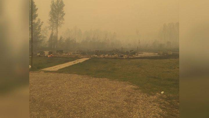 Man sings gospel as he watches his home burn in northern Alberta fire