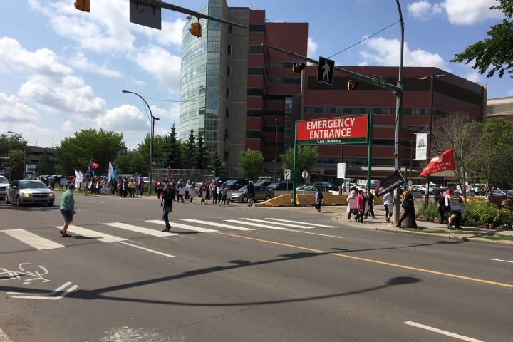 Alberta health workers march outside University Hospital, protesting Bill 9