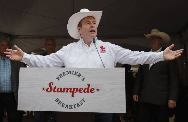 Protesters target Kenney at Calgary Stampede over gay-straight alliances