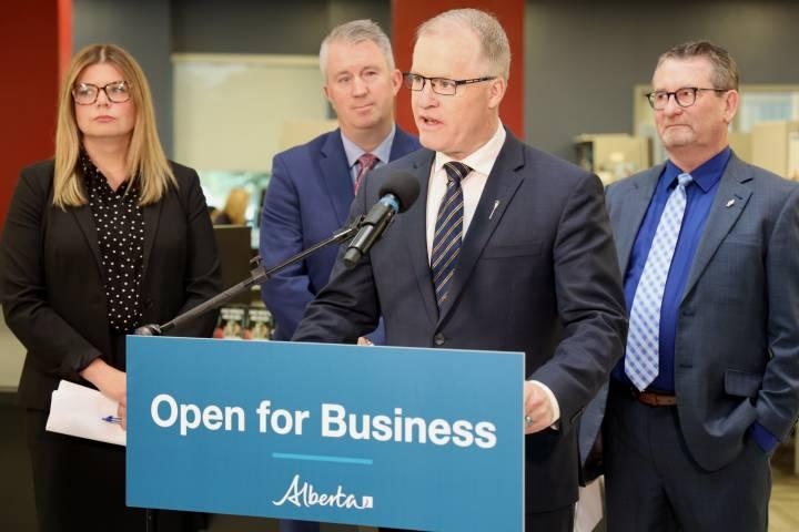 Cutting pink tape: Alberta auto insurance cards going digital