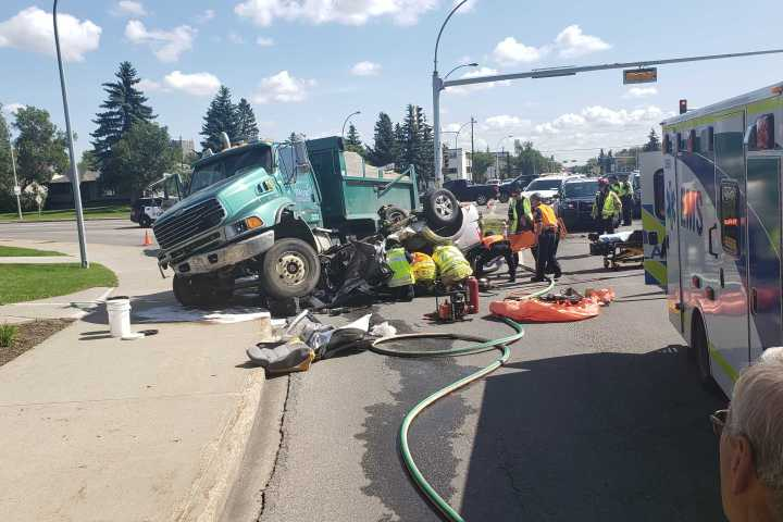 Vehicle crushed by dump truck at major Westmount intersection wreaks traffic havoc