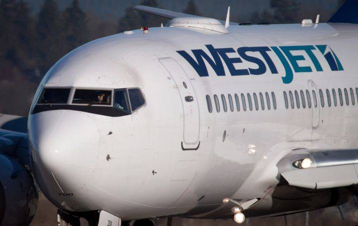 Edmonton couple receives $1,800 from WestJet after filing complaint under new passenger rights rules