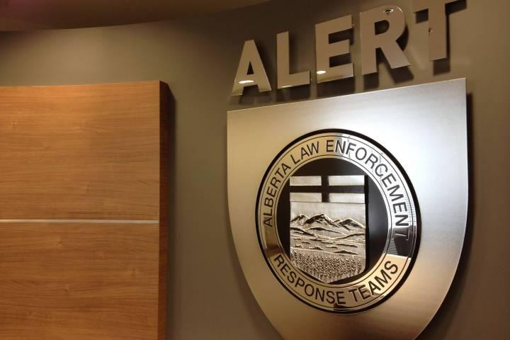 Rifles, handguns, sawed-off shotgun seized from Red Deer home