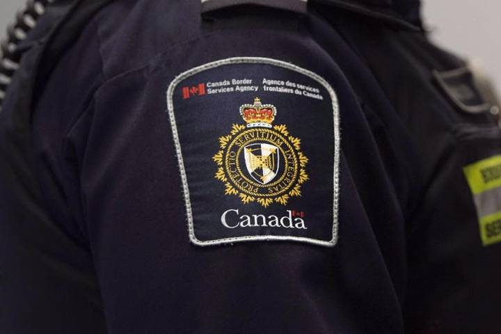 Police accuse man of taking young child hostage in Edmonton CBSA office