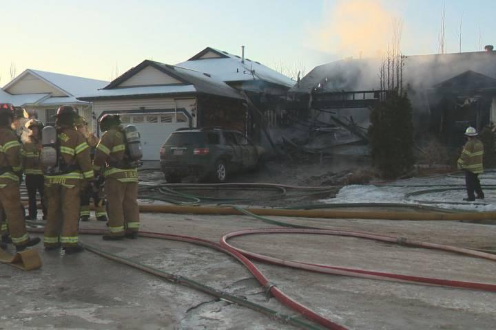 All residents safe after fire destroys garage, damages home in northwest Edmonton