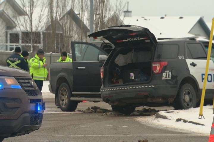 Major collisions investigating after Edmonton police vehicle struck by truck