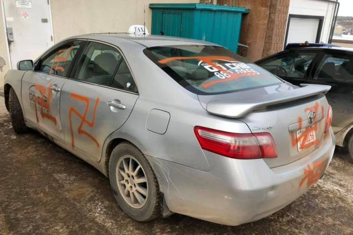 After taxi was spray-painted with swastikas, northern Alberta community rallied to help owner