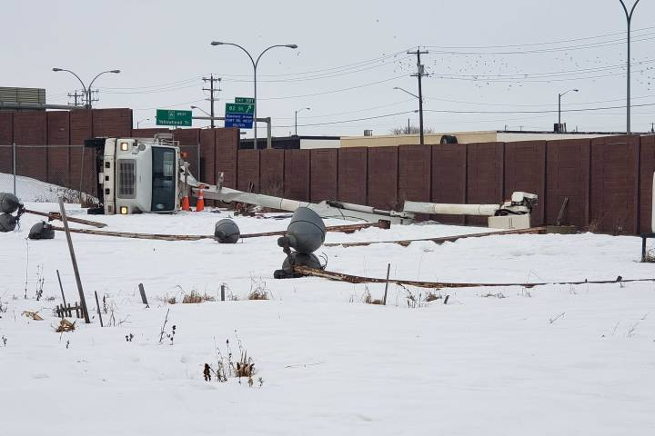 Worker pinned under bucket of tipped picker truck in north Edmonton