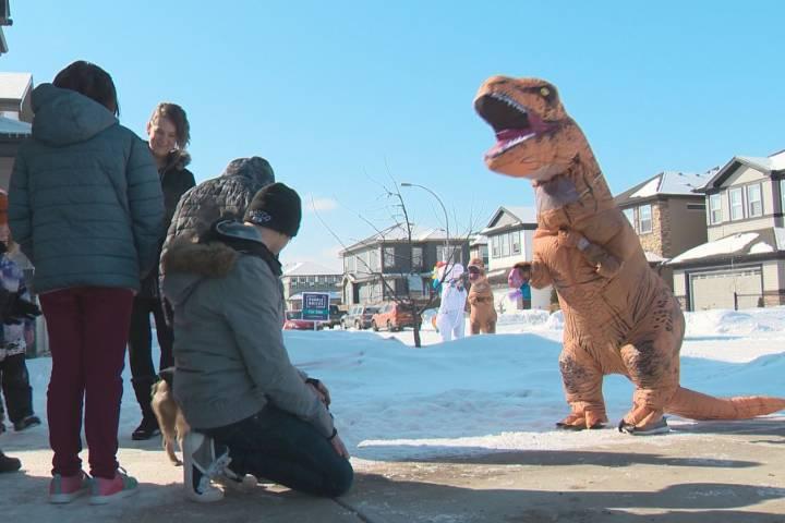 Community members in dinosaur costumes wish Edmonton boys happy birthday amid COVID-19 pandemic