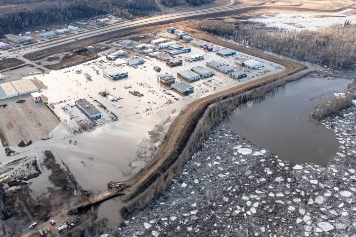 Fort McMurray cleans up from flood on anniversary of 2016 wildfire evacuation