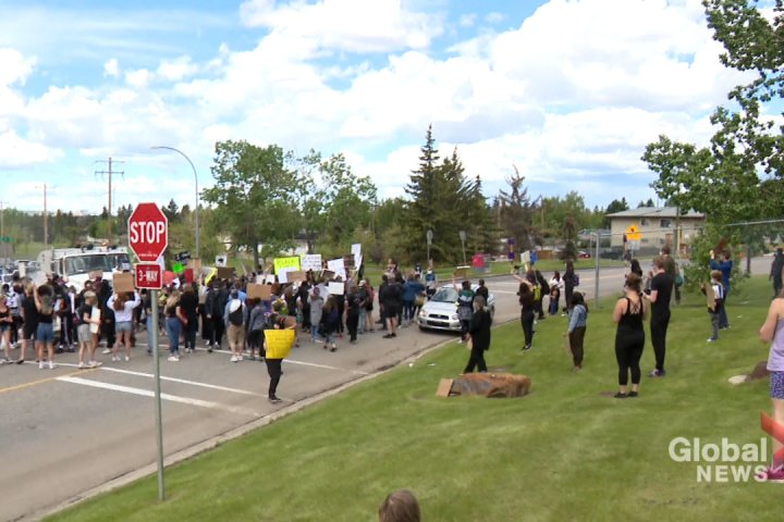 Calgary police hate crimes unit investigating after car drove through protesters