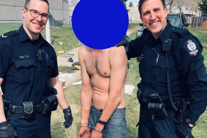 Instagram post of smiling Edmonton police officers posing with detained man to be investigated: EPS
