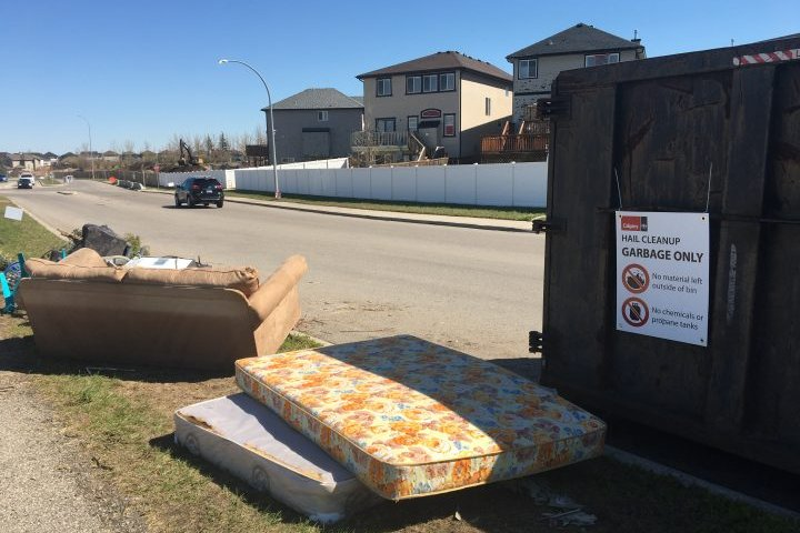 'It's an emotional thing': Calgary residents with hail-damaged homes flock to community support centre
