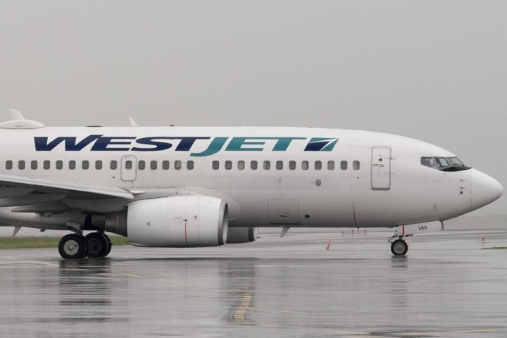 WestJet will end physical distancing on flights starting July 1