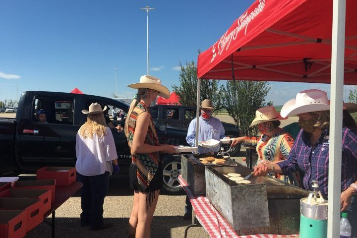 First-ever Calgary Stampede drive-thru pancake breakfast puts the boots to COVID-19 gloom