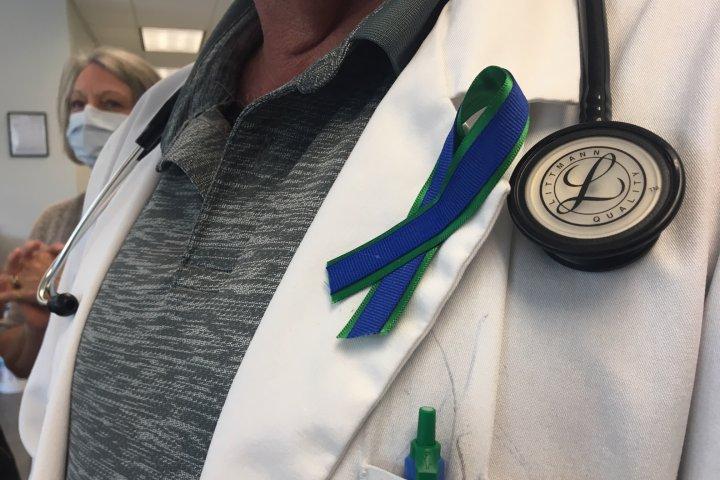Ribbons symbolizing solidarity worn to honour slain Red Deer family doctor