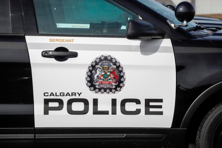 Senior run over by stolen vehicle, Calgary police searching for driver