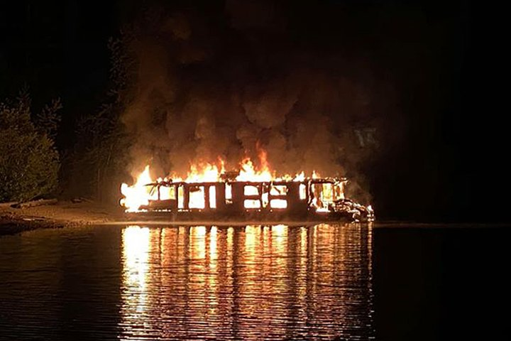 Shuswap houseboat destroyed in overnight fire; Alberta family lends helping hand