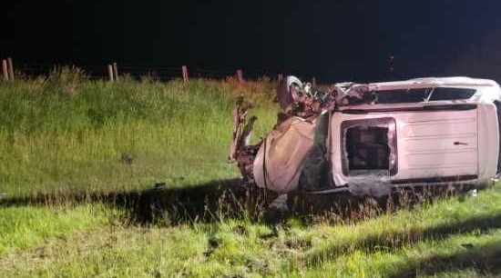 Vehicle drives into oncoming highway traffic, clips semi-truck and catches fire in ditch: Cochrane RCMP