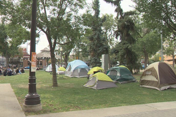 New homeless camp pops up in Old Strathcona as city wants end date for Rossdale's Camp Pekiwewin