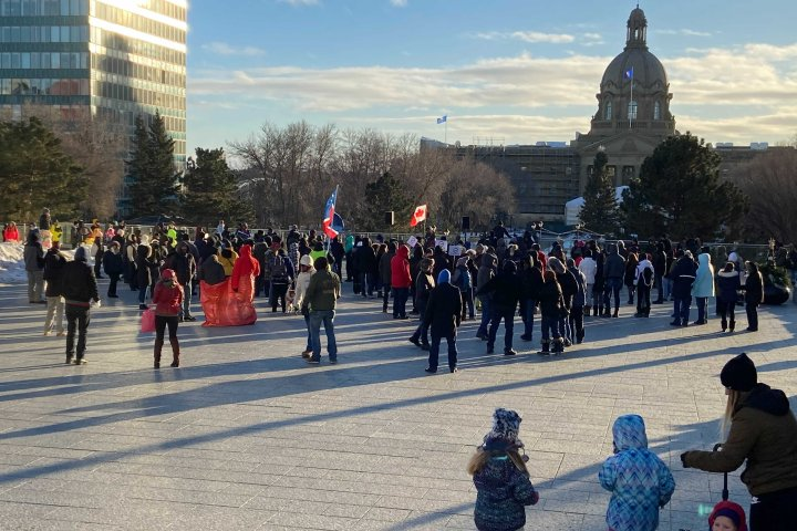 Calgary, Edmonton protesters rally against COVID-19 measures as Alberta adds 1,590 new cases