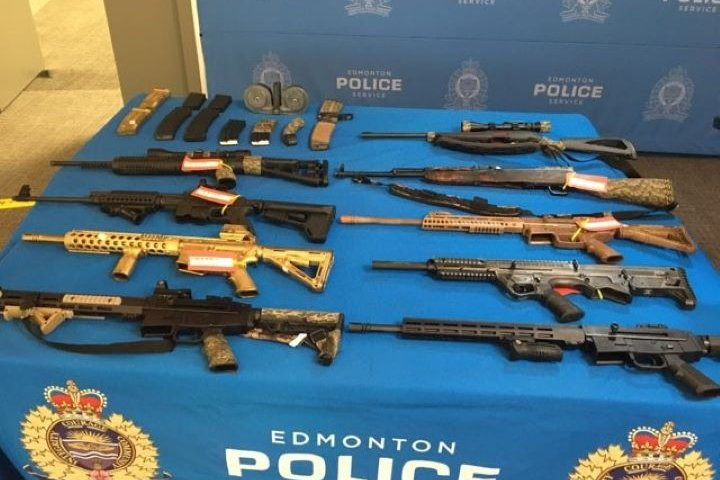 Gun for sale on buy and sell website leads Edmonton police to charge 2 men with firearms trafficking