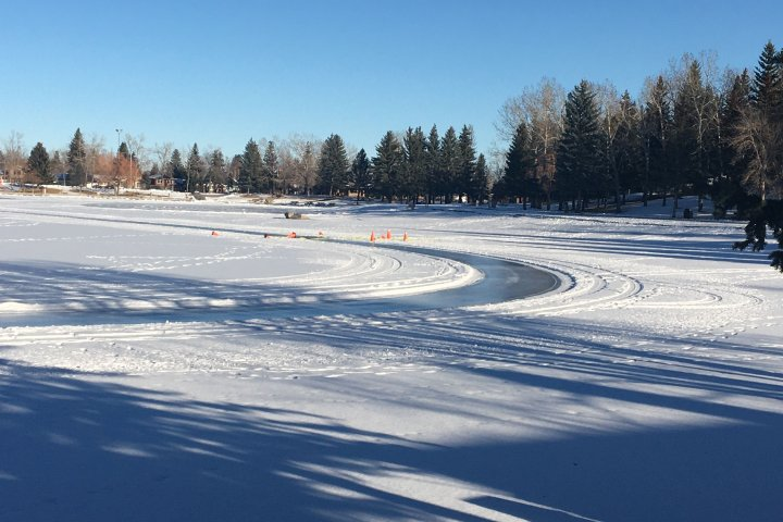 Woman in stable condition after falling through ice while operating tractor: Calgary fire