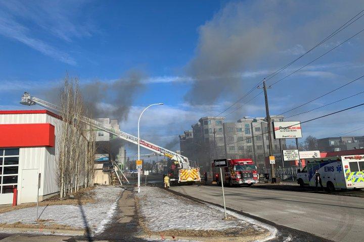 Crews battle active fire at Edmonton commercial building