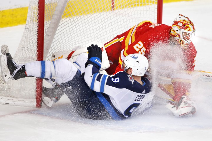 Winnipeg Jets beat Calgary Flames 4-0 to snap 7-game losing streak and clinch playoff spot