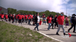 Tsuut'ina Nation hosts silent march to honour residential school victims