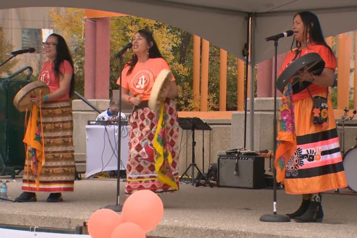 Calgarians gather downtown for Orange Shirt walk to support residential school survivors