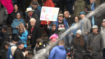 Protesters at Olympic Plaza in Calgary oppose mandatory vaccinations